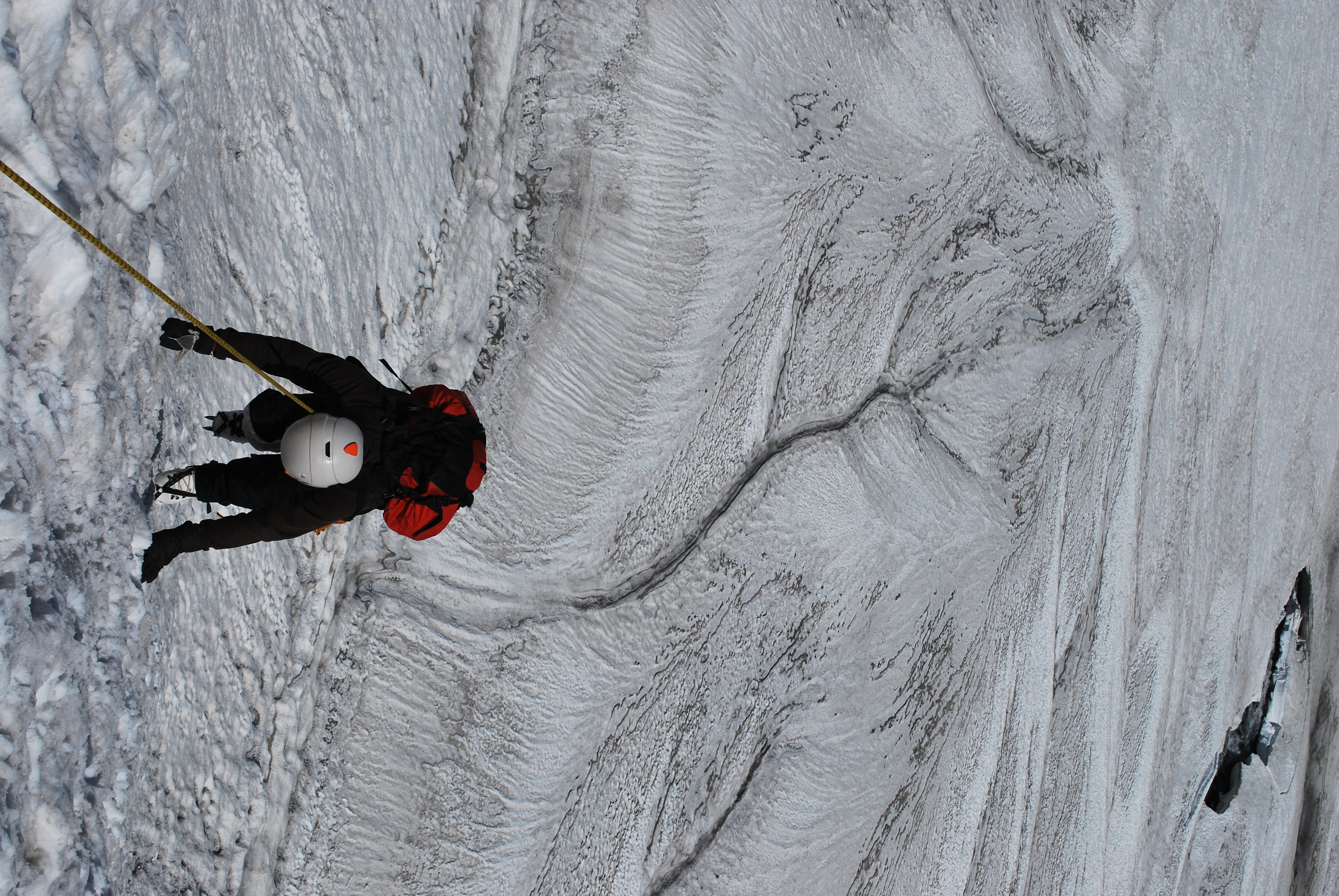 climbing on steep ice snow slope Mountain training.JPG